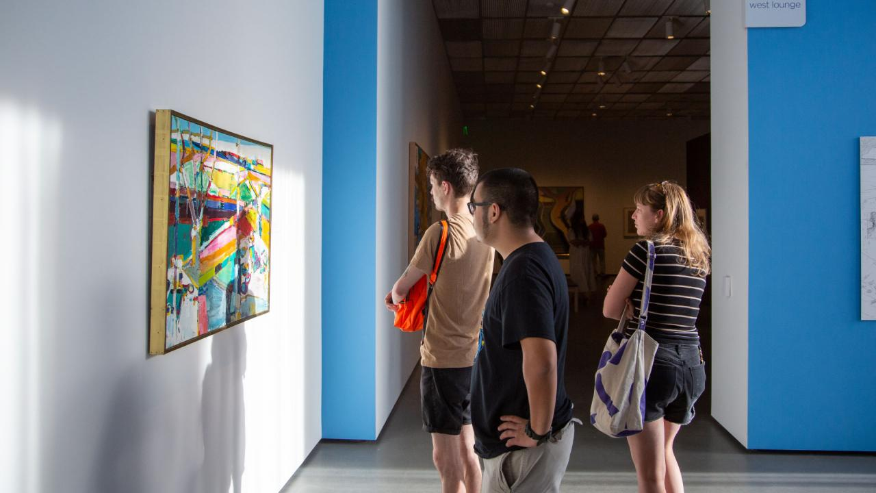 People looking at art in the gallery.