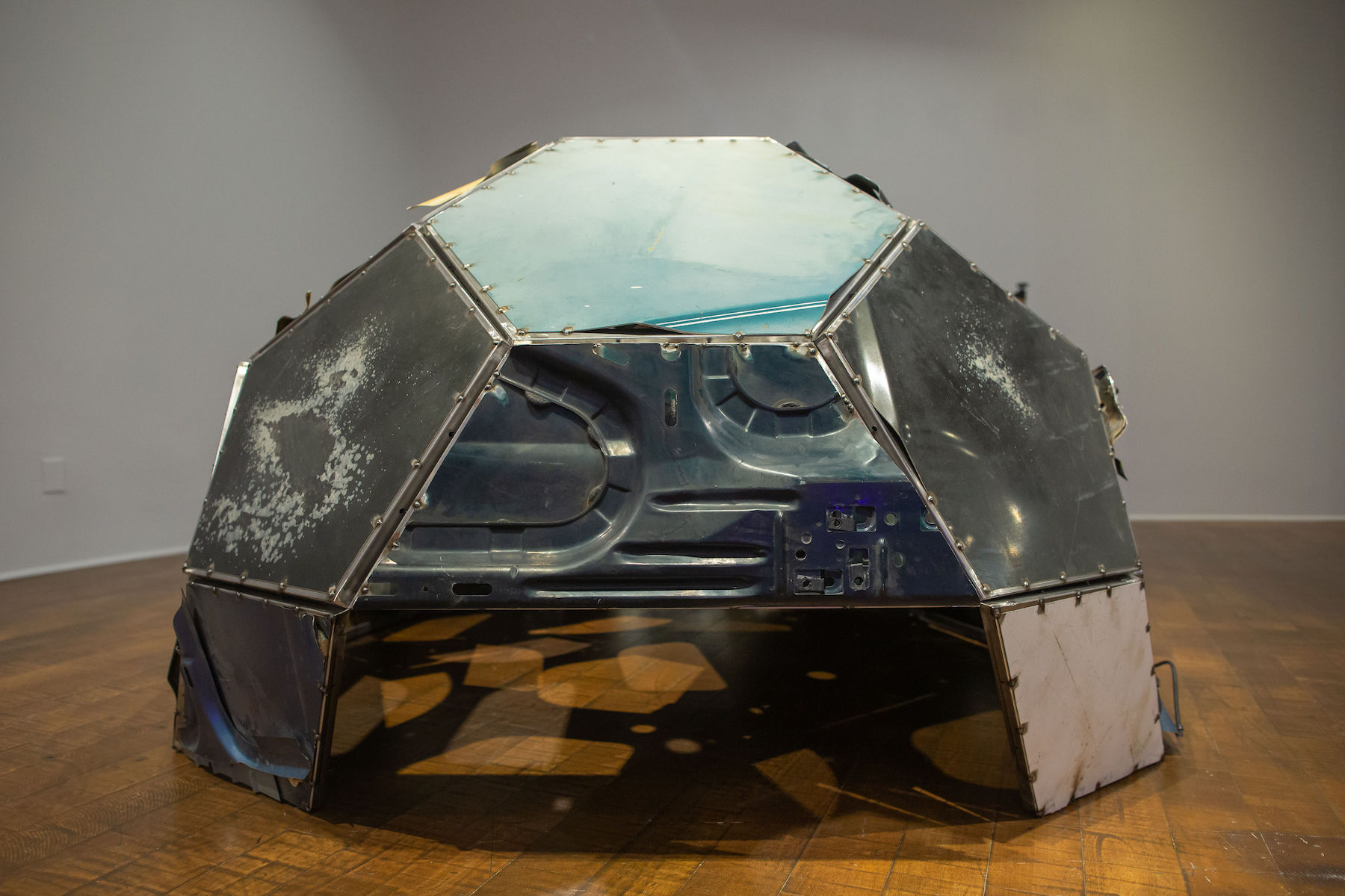 Photo of artwork by Beatriz Cortez with glass and metal in a dome shape.