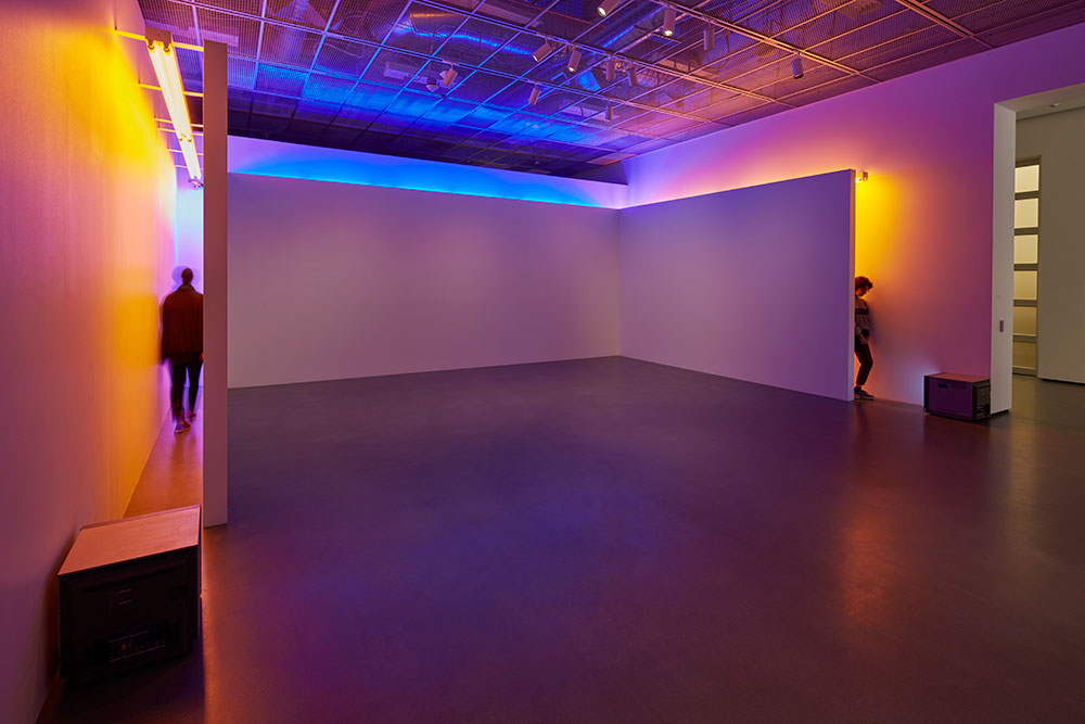 Installation photo of Bruce Nauman's Blue and Yellow Corridor at the Manetti Shrem Museum.
