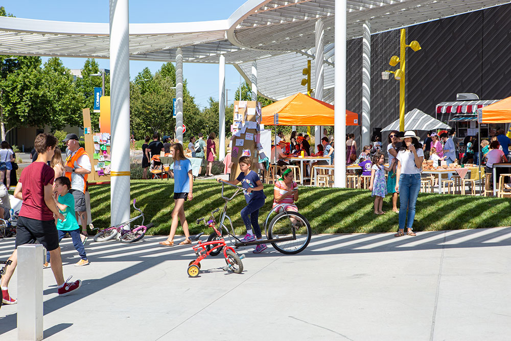 Photo of kids riding bikes at the museum's summer event.