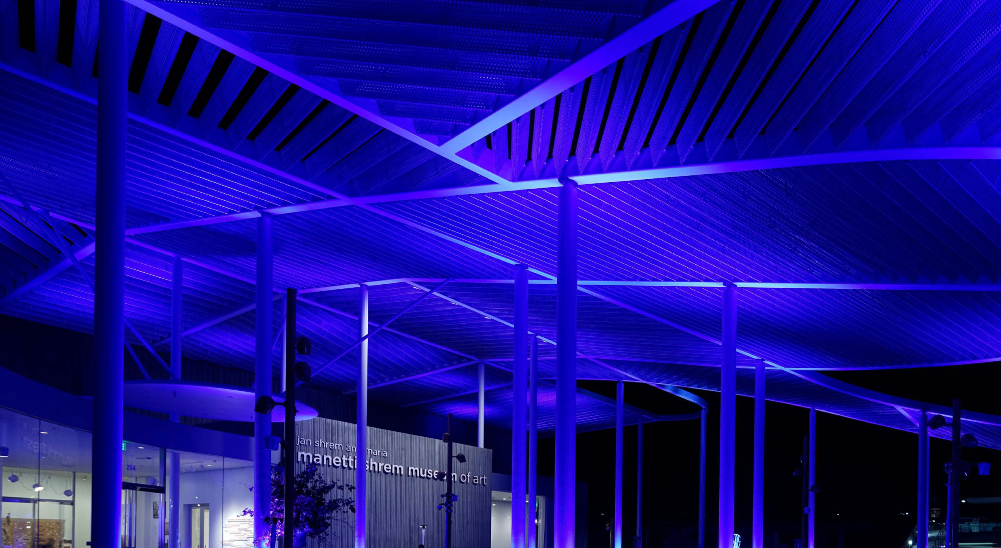 Photo of the Manetti Shrem Museum Event Plaza lit at night.