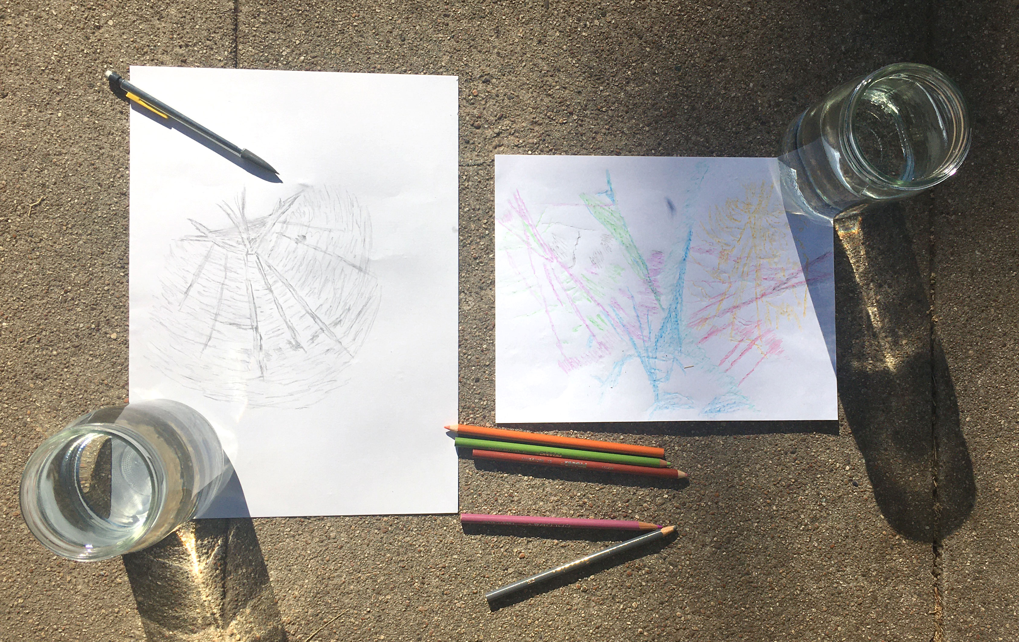 Artwork with colored pencils and regular pencil created by tracing the lines and shapes of sun shining through a water filled glass.