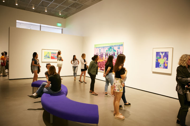 Photo of students in the galleries looking at art.