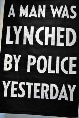 "PHOTOS BY RICHARD BAMMER — THE REPORTER Artist Dread Scott created ""A Man Was Lynched By Police Yesterday"" (2007), a silkscreen on nylon."