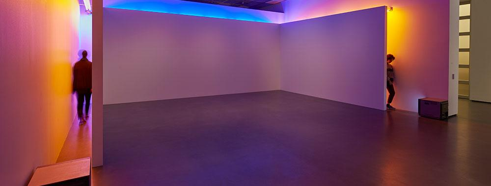 Installation photo of Bruce Nauman's Blue and Yellow Corridor at the Museum.