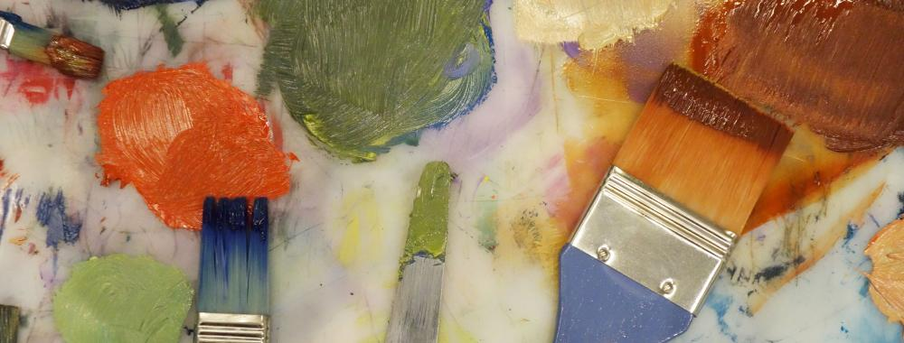 Photo of paint and paintbrushes.