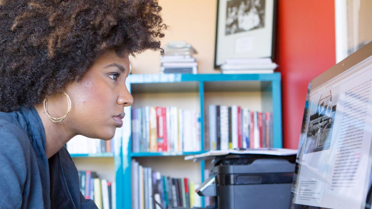 LaToya Ruby Frazier working at her computer